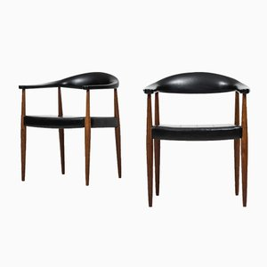 Skai and Teak Armchairs from ASKO