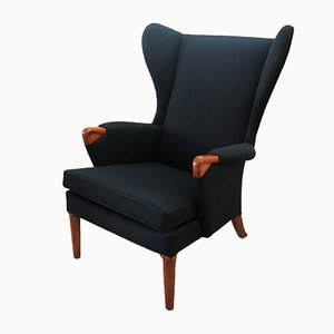 Black Wingback Chair with Teak Legs from Parker Knoll, 1960s
