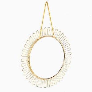 Specchio rotondo dalla cornice in ottone, anni '60