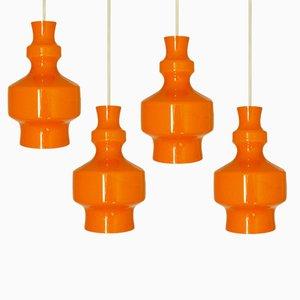 Lampade a sospensione vintage in vetro arancione di Raak, anni '60, set di 4
