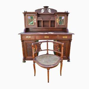 Scrivania Art Nouveau antica in noce intagliata con poltrona