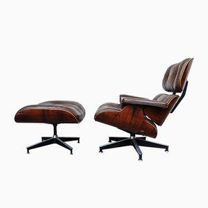 Vintage Palisander Furnier Sessel & Ottoman von Charles & Ray Eames für Herman Miller, 1978