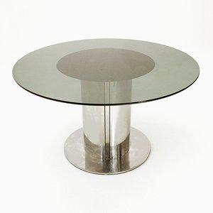 Tavolo da ptanzo rotondo con ripiano in vetro di Cidue, anni '70