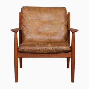 Cognacfarbener dänischer Vintage Teak & Leder Sessel von Grete Jalk für France & Søn, 1960er