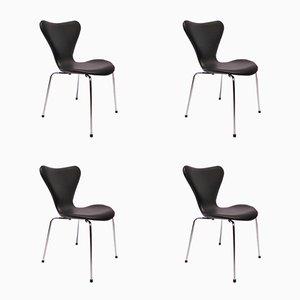 Modell 3107 Seven Stühle aus schwarzem Leder von Arne Jacobsen für Fritz Hansen, 1980er, 4er Set