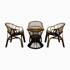 Tavolo rotondo e 3 sedie di Tito Agnoli per Pierantonio Bonacina, anni '60