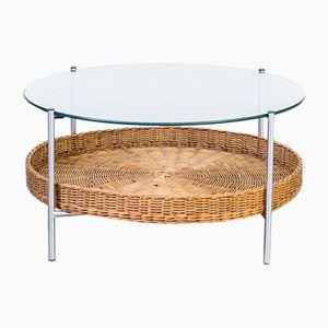 Mesa de centro redonda de vidrio con revistero de mimbre, años 70