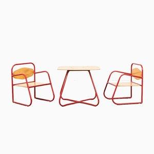 Juego de sillas y mesa infantil de acero tubular, 1981