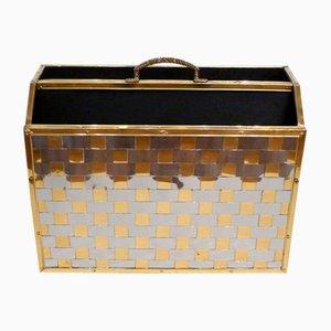 Revistero con bandas metálicas en dorado y plateado, años 70