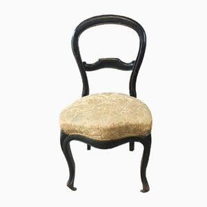 Antiker französischer Stuhl mit Eisenrollen