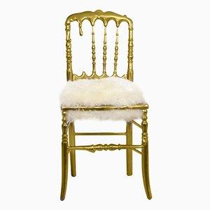 Vergoldeter Emporium Stuhl mit Fellsitz von Covet House