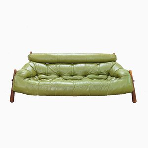Divano verde di Percival Lafer