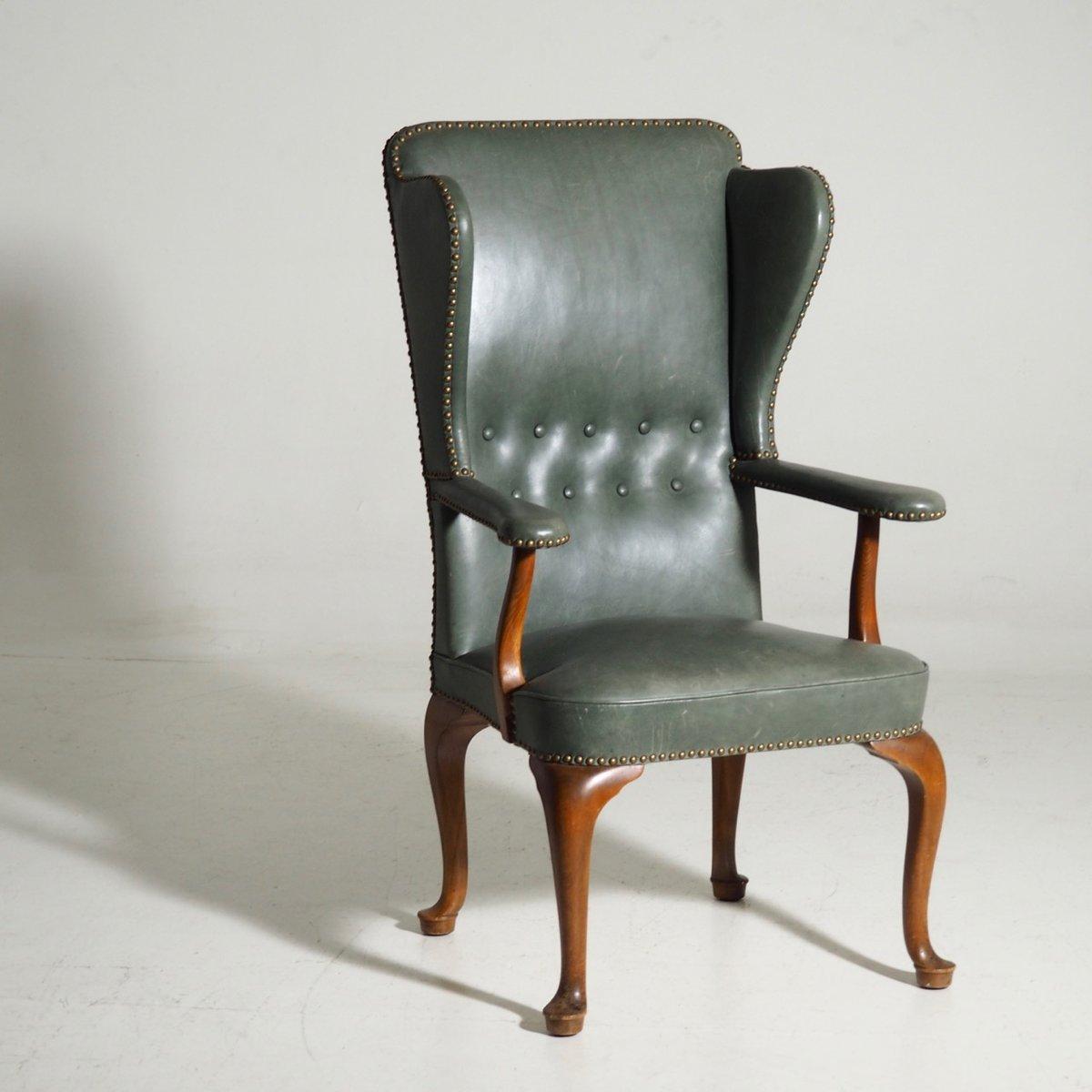 vintage leder ohrensessel in gr n bei pamono kaufen. Black Bedroom Furniture Sets. Home Design Ideas