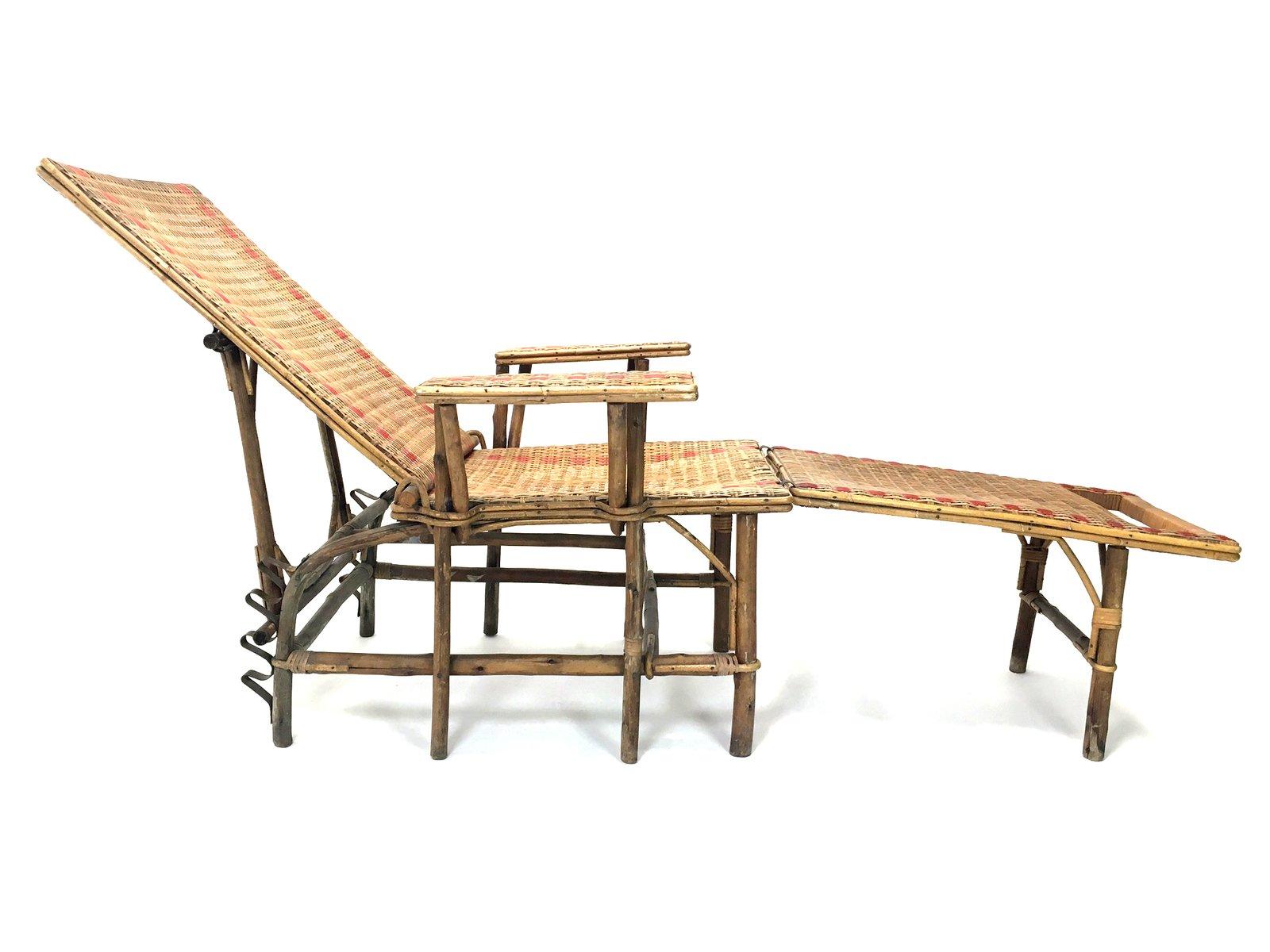 Poltrona con poggiapiedi in vimini e bamboo, Francia, anni \'20 in ...