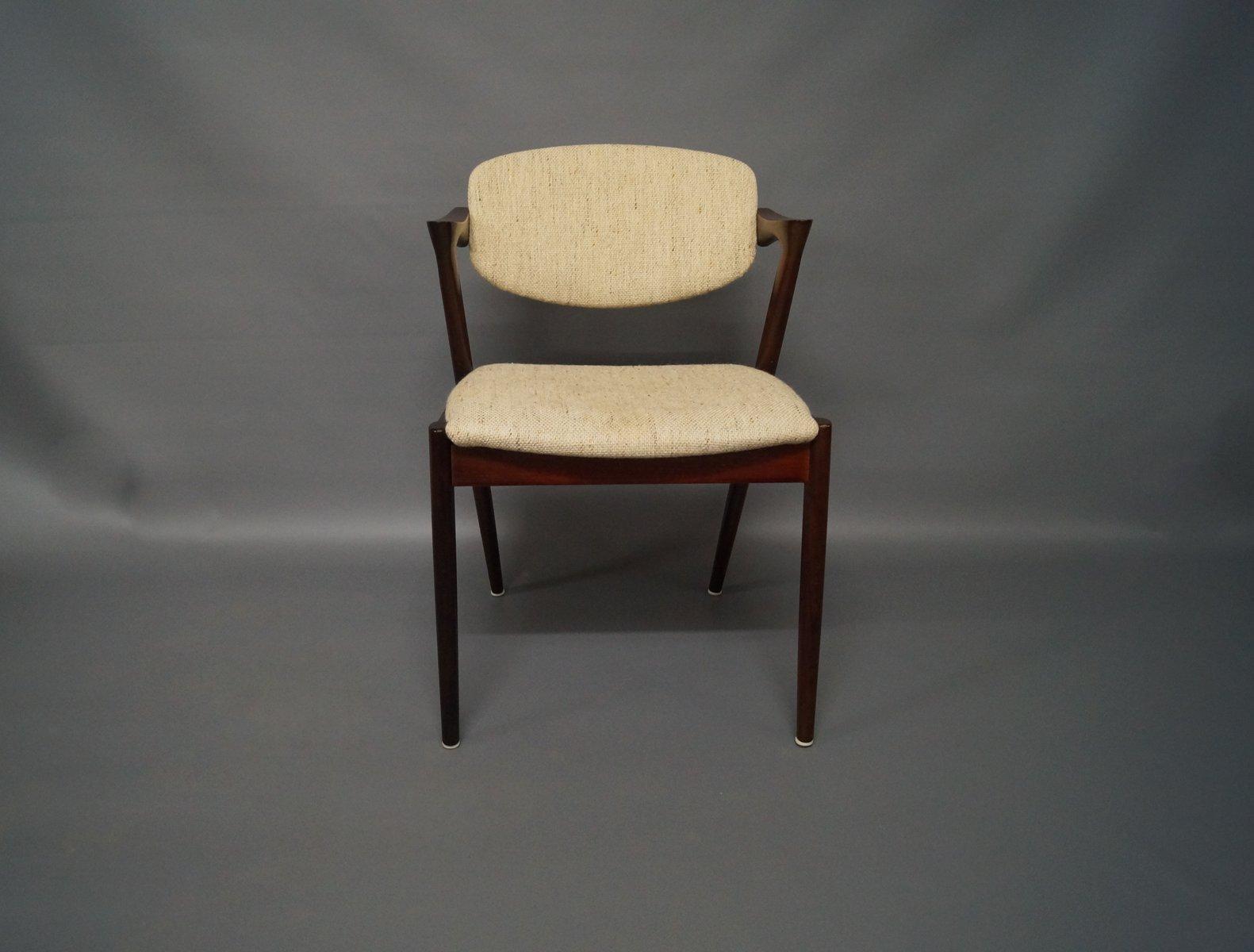 Chaises de salle manger mod le 42 en palissandre par kai for Modele de chaises salle a manger