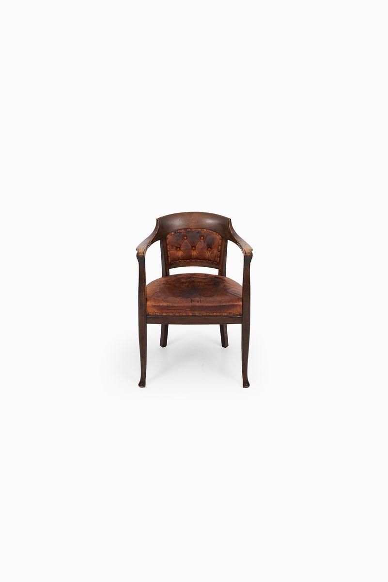 Sessel aus dunkel gebeizter eiche und braunem leder for Sessel aus leder