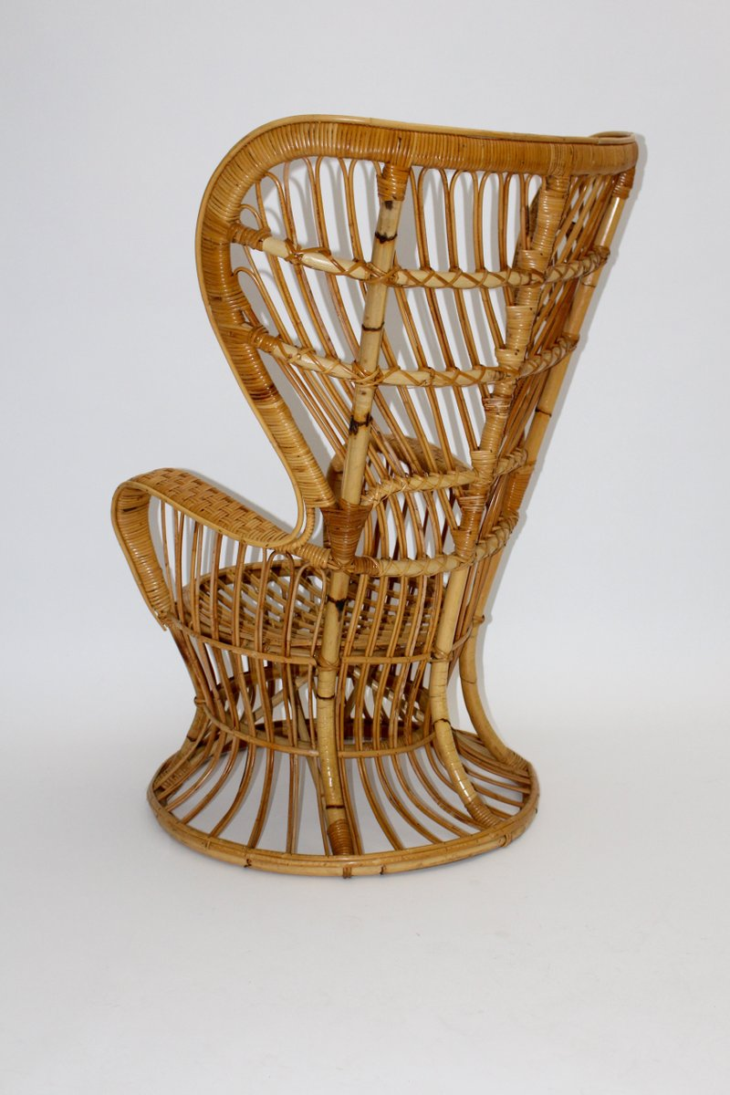 Italian Rattan Peacock Chair By Lio Carminati 7. $3,870.00. Price Per Piece