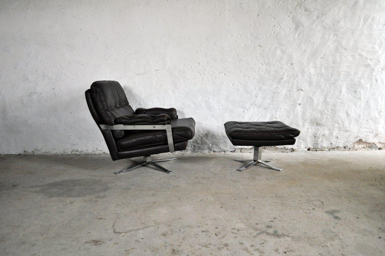 dunkelbrauner vintage sessel aus leder chrom mit hocker von arne norell f r vatne bei pamono. Black Bedroom Furniture Sets. Home Design Ideas
