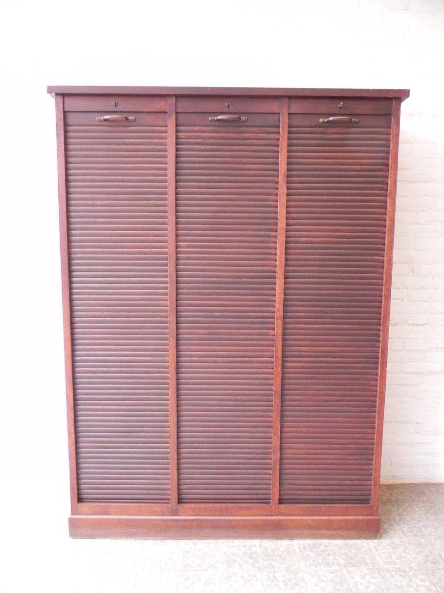 vintage eichenholz schrank mit 3 rollt ren bei pamono kaufen. Black Bedroom Furniture Sets. Home Design Ideas