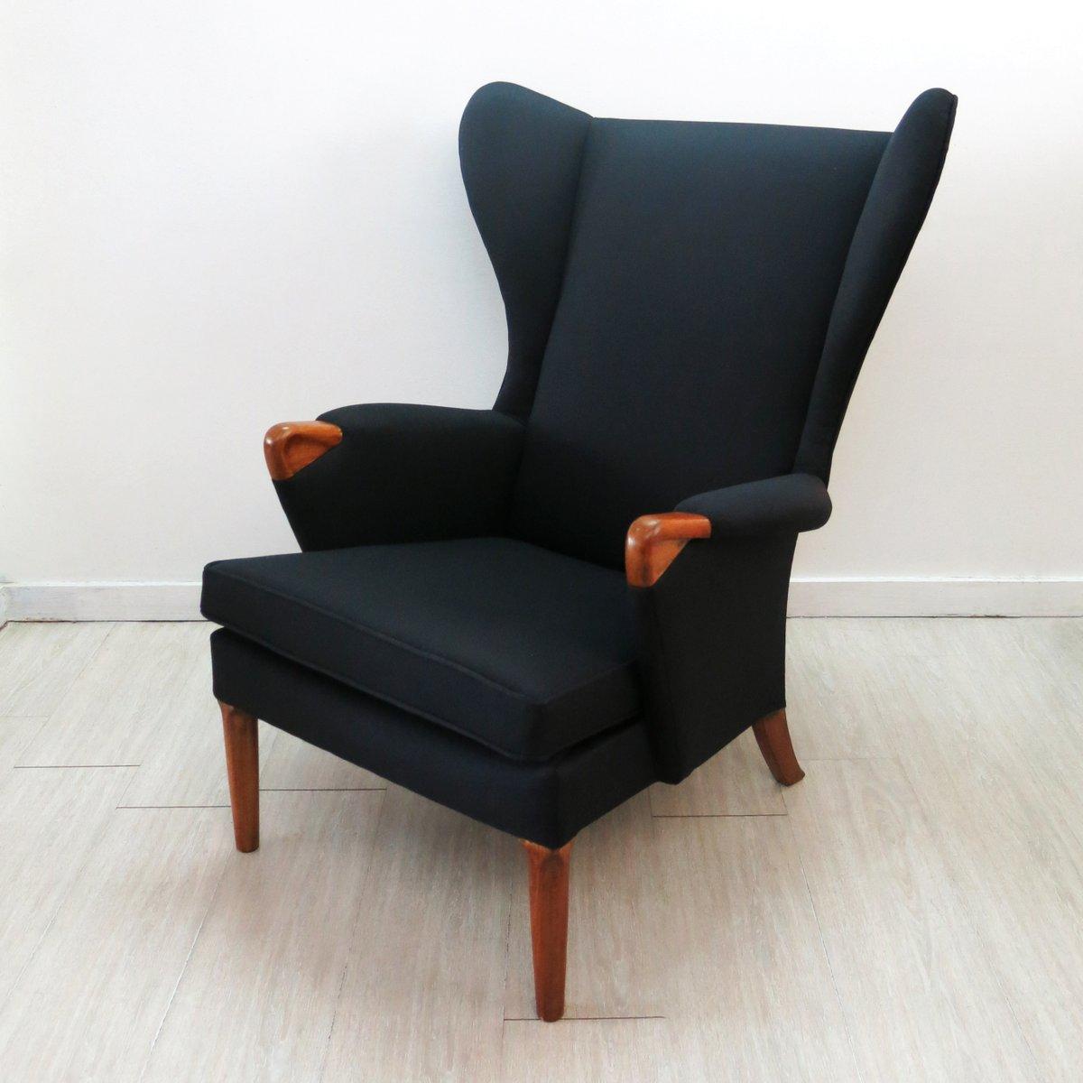 fauteuil oreilles noir avec pieds en teck de parker. Black Bedroom Furniture Sets. Home Design Ideas