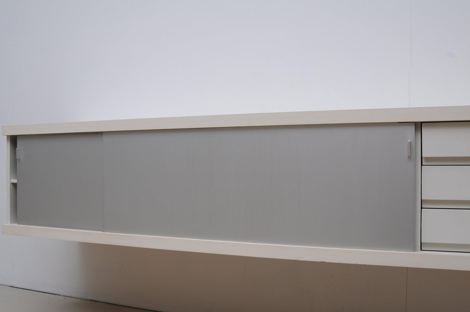 schwebendes mid century sideboard von horst br ning f r. Black Bedroom Furniture Sets. Home Design Ideas