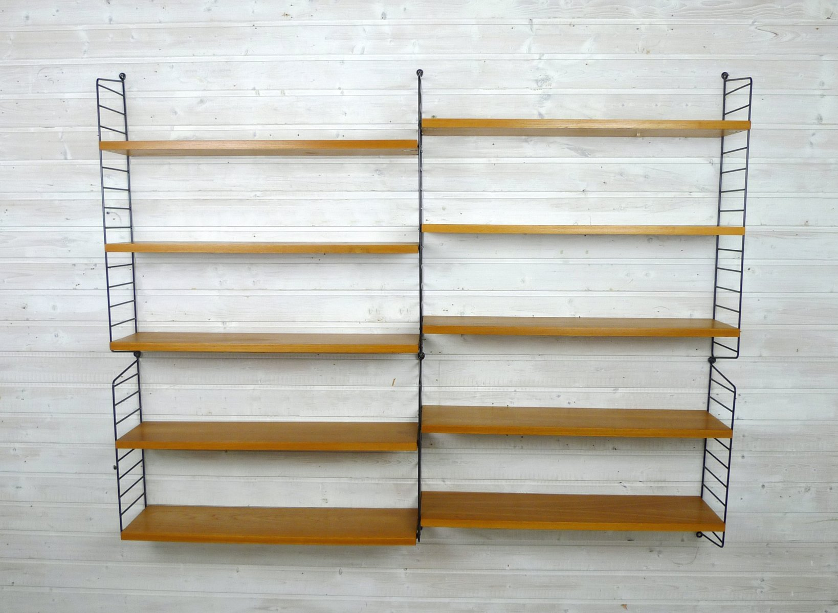 Nisse Strinning wall shelf system made of ash by nisse strinning for string sweden