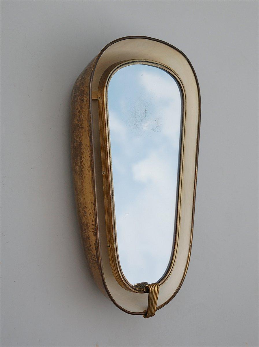 Miroir mural art d co avec eclairage et structure en for Deco miroir mural