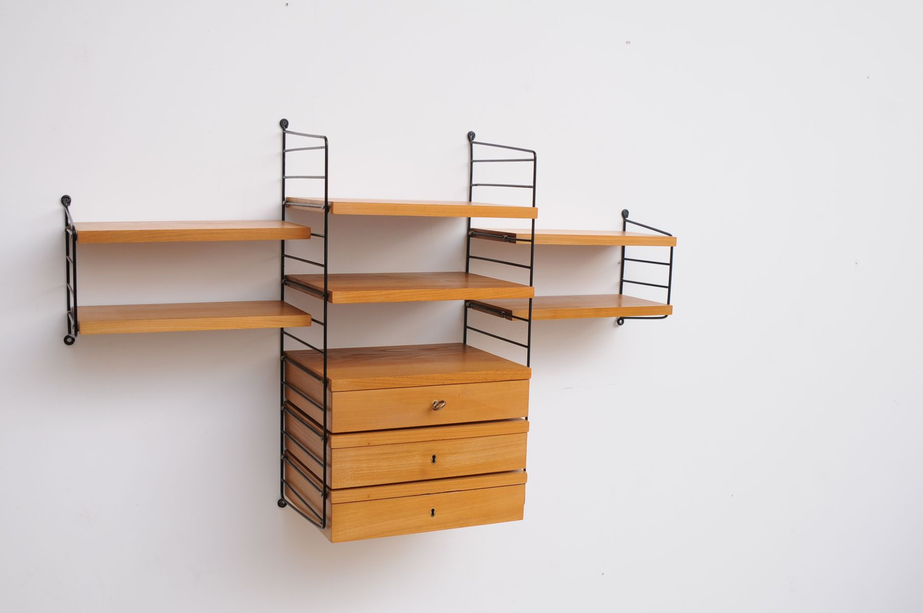 Nisse Strinning vintage shelving system in cherry by nisse strinning for