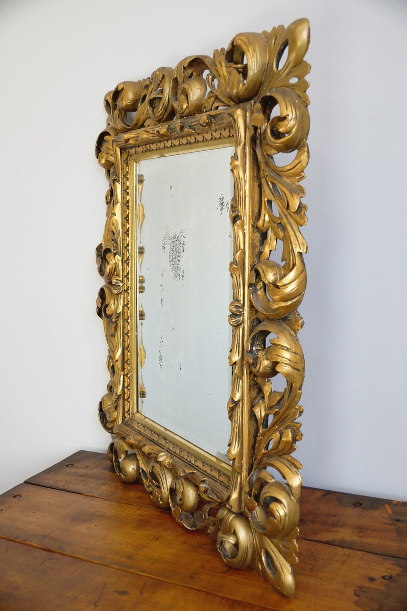 18th century baroque mirror with carved wooden frame for