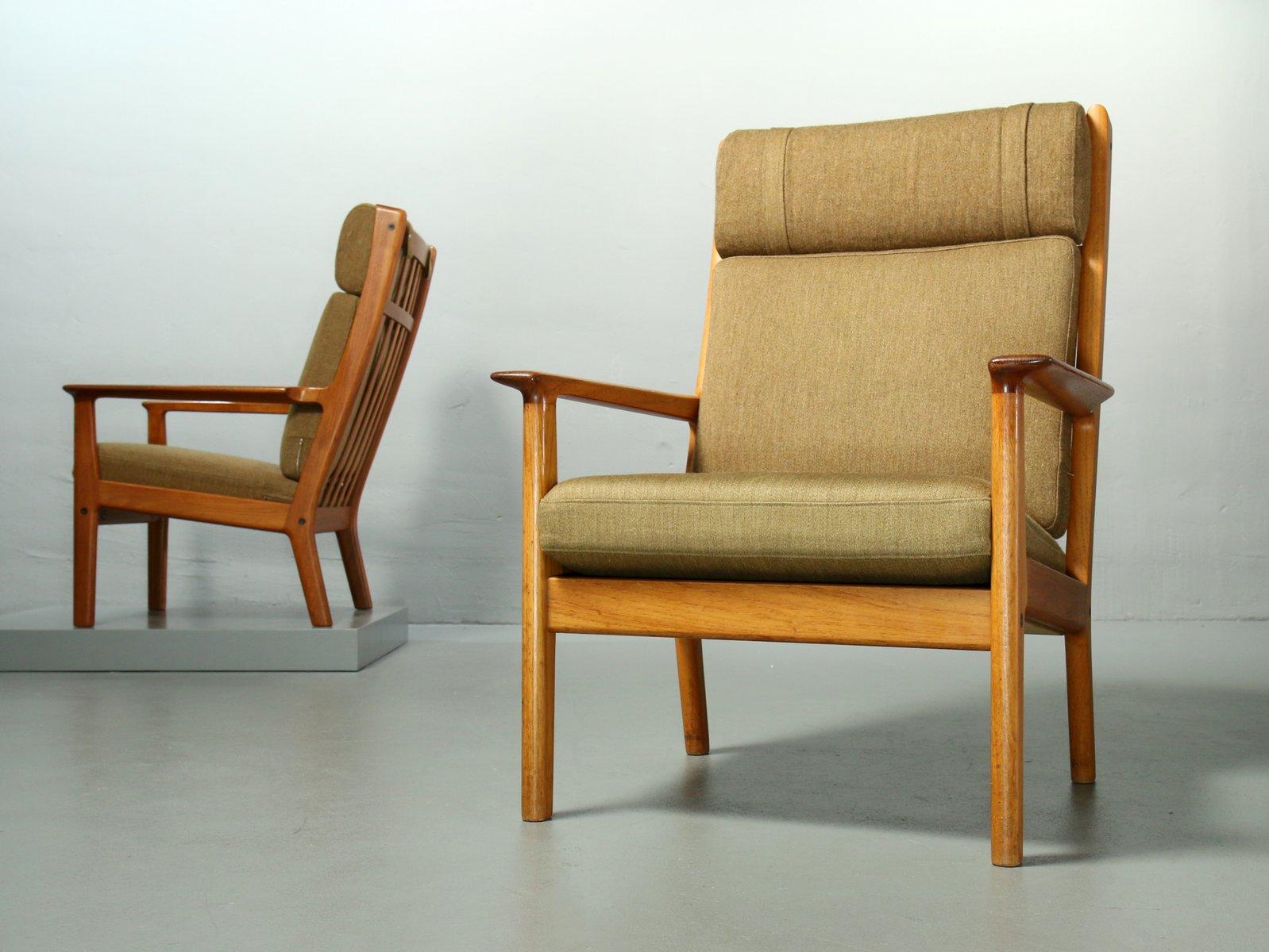 65a teak sessel mit hoher r ckenlehne von hans j wegner f r getama 1970er 2er set bei pamono. Black Bedroom Furniture Sets. Home Design Ideas