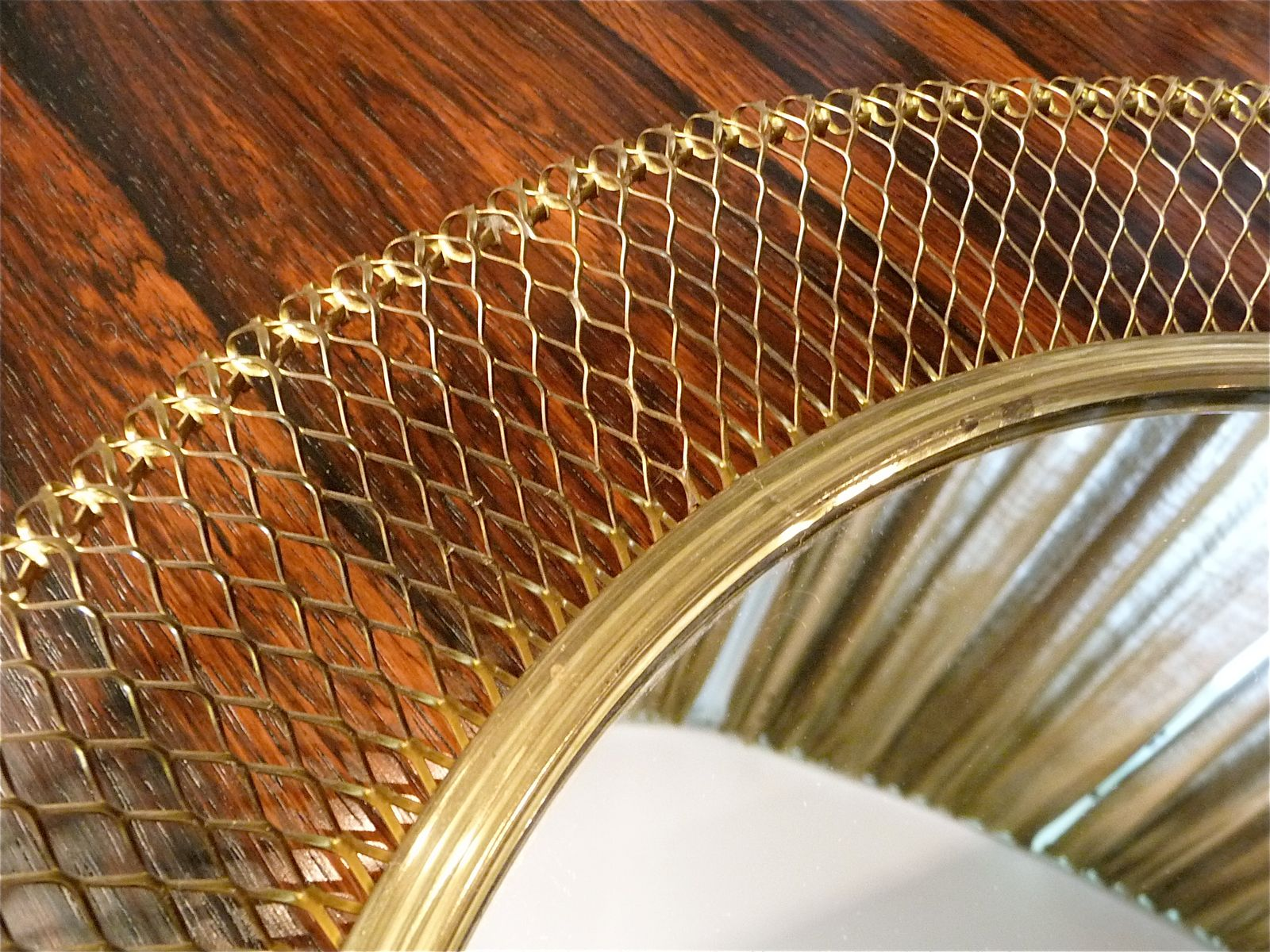Mid century round brass wire mesh wall mirror for sale at