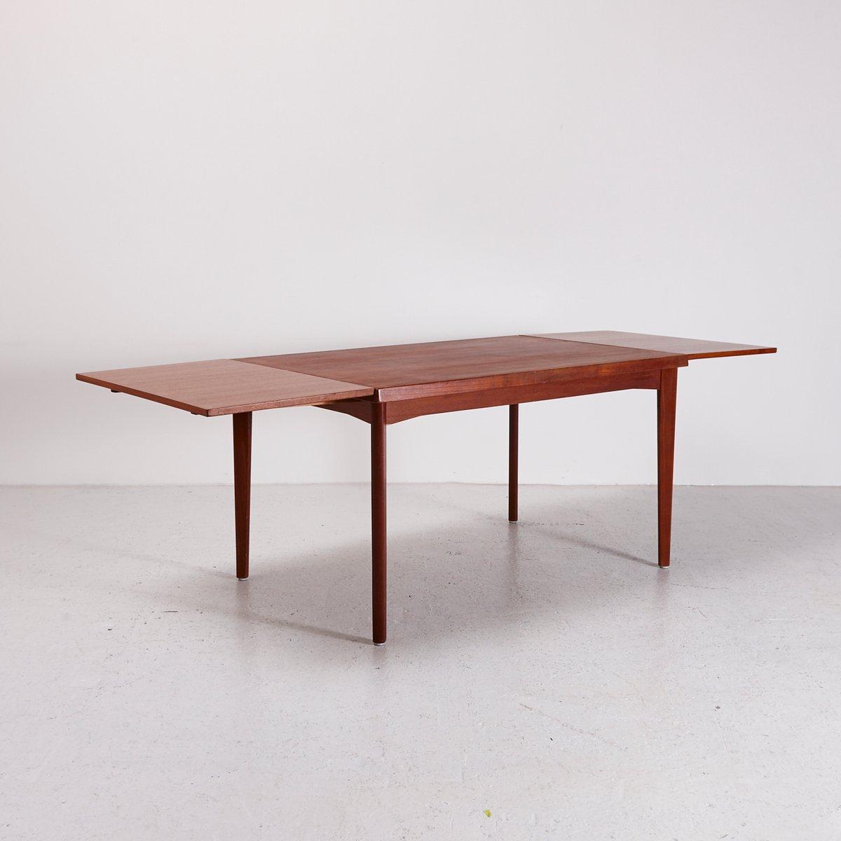 ausziehbarer esstisch aus teak von henning kj rnulf f r. Black Bedroom Furniture Sets. Home Design Ideas