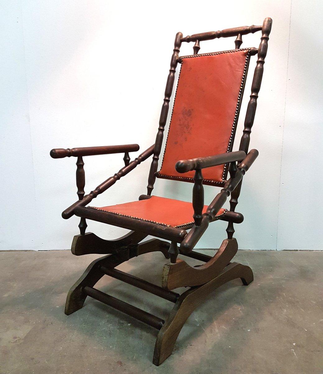skandinavischer vintage schaukelstuhl mit patiniertem leder bei pamono kaufen. Black Bedroom Furniture Sets. Home Design Ideas