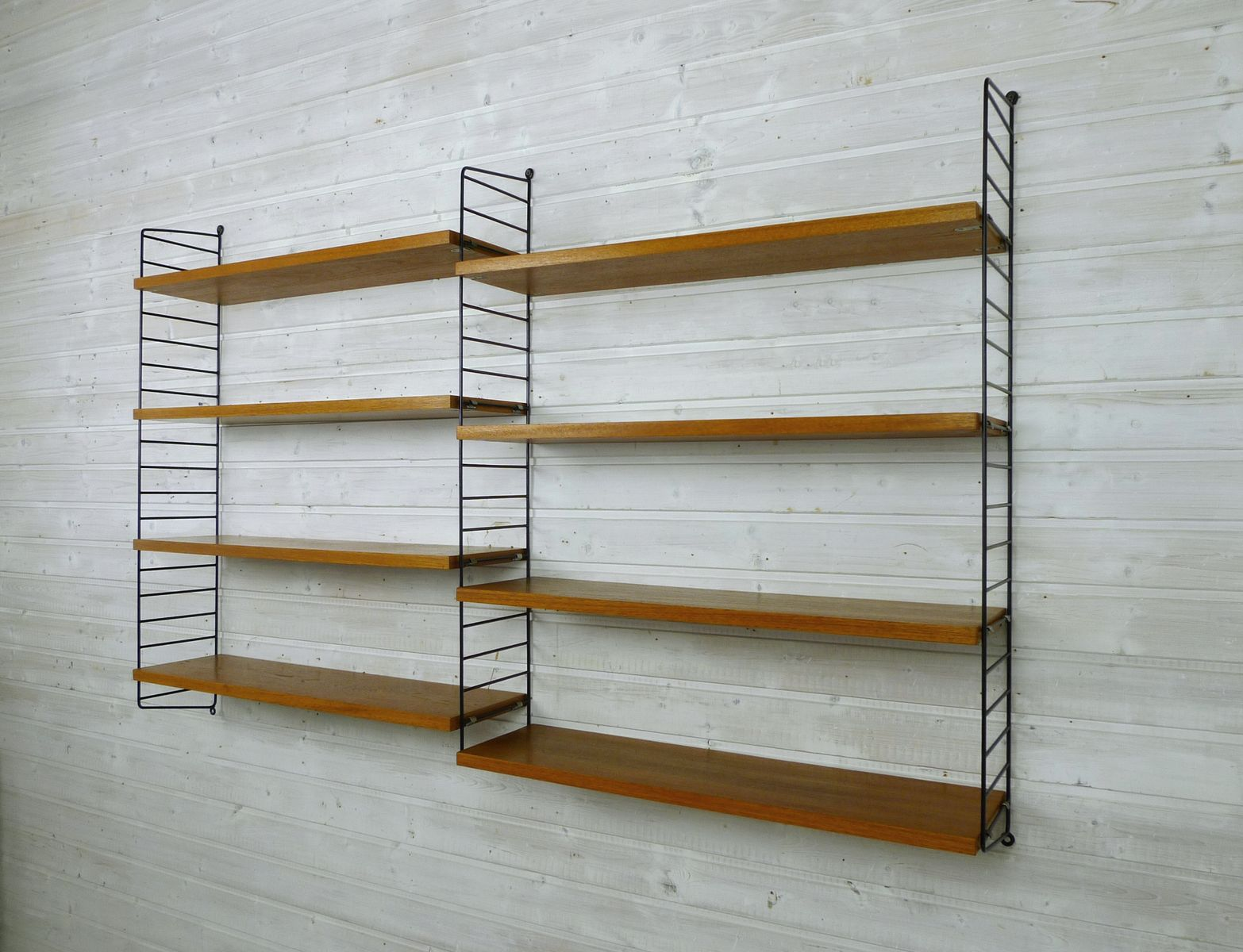 Nisse Strinning wall unit with 8 teak shelves by nisse strinning for string