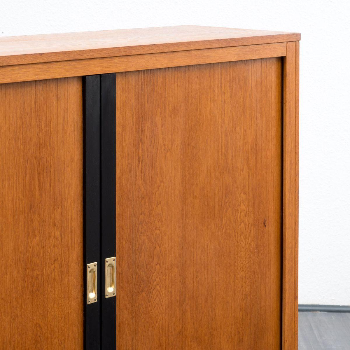 industrial oak cabinet with sliding doors 1950s for sale. Black Bedroom Furniture Sets. Home Design Ideas