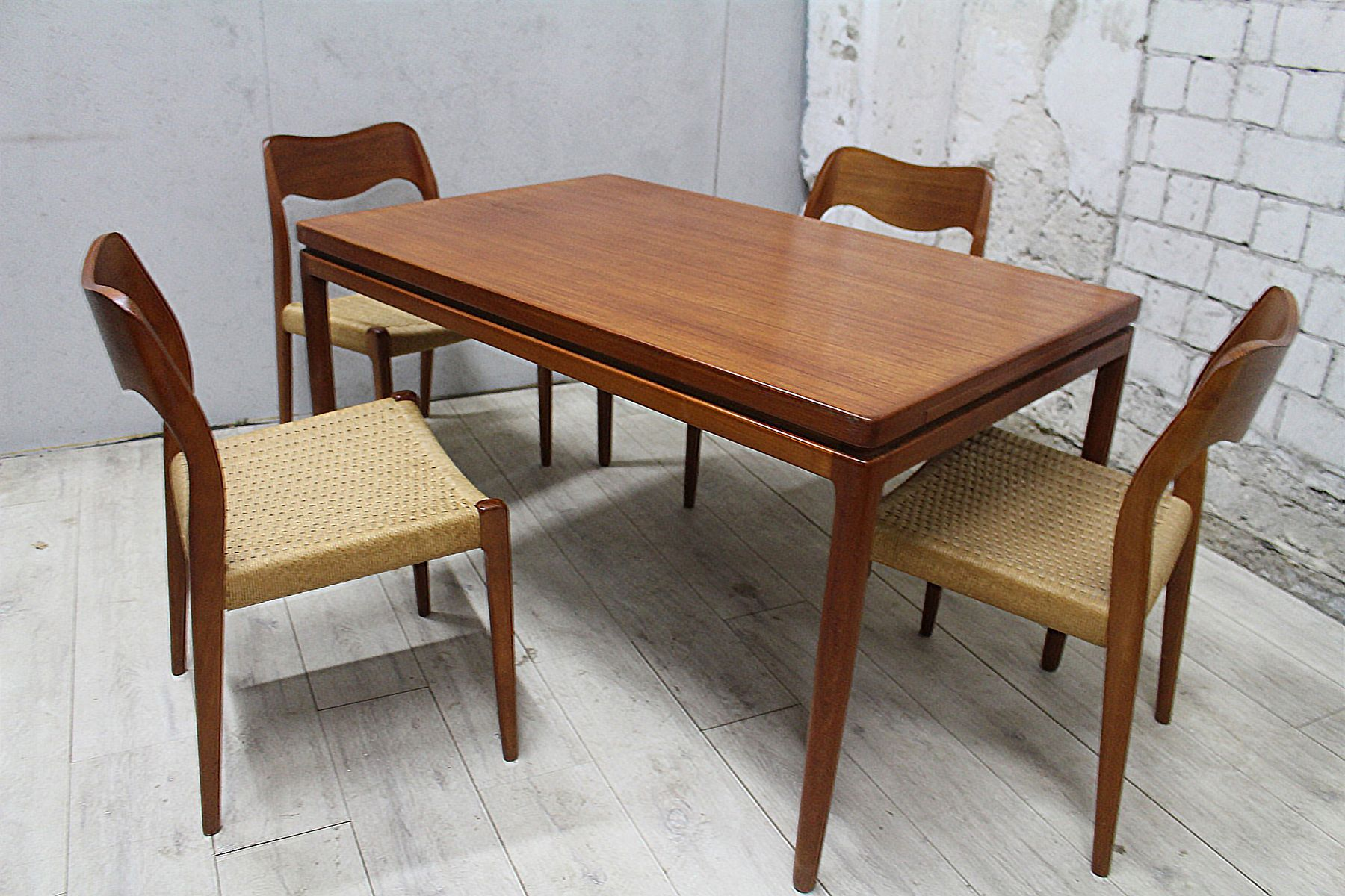 No 75 Chairs and Dining Table Set by N O M¸ller for J L M¸llers