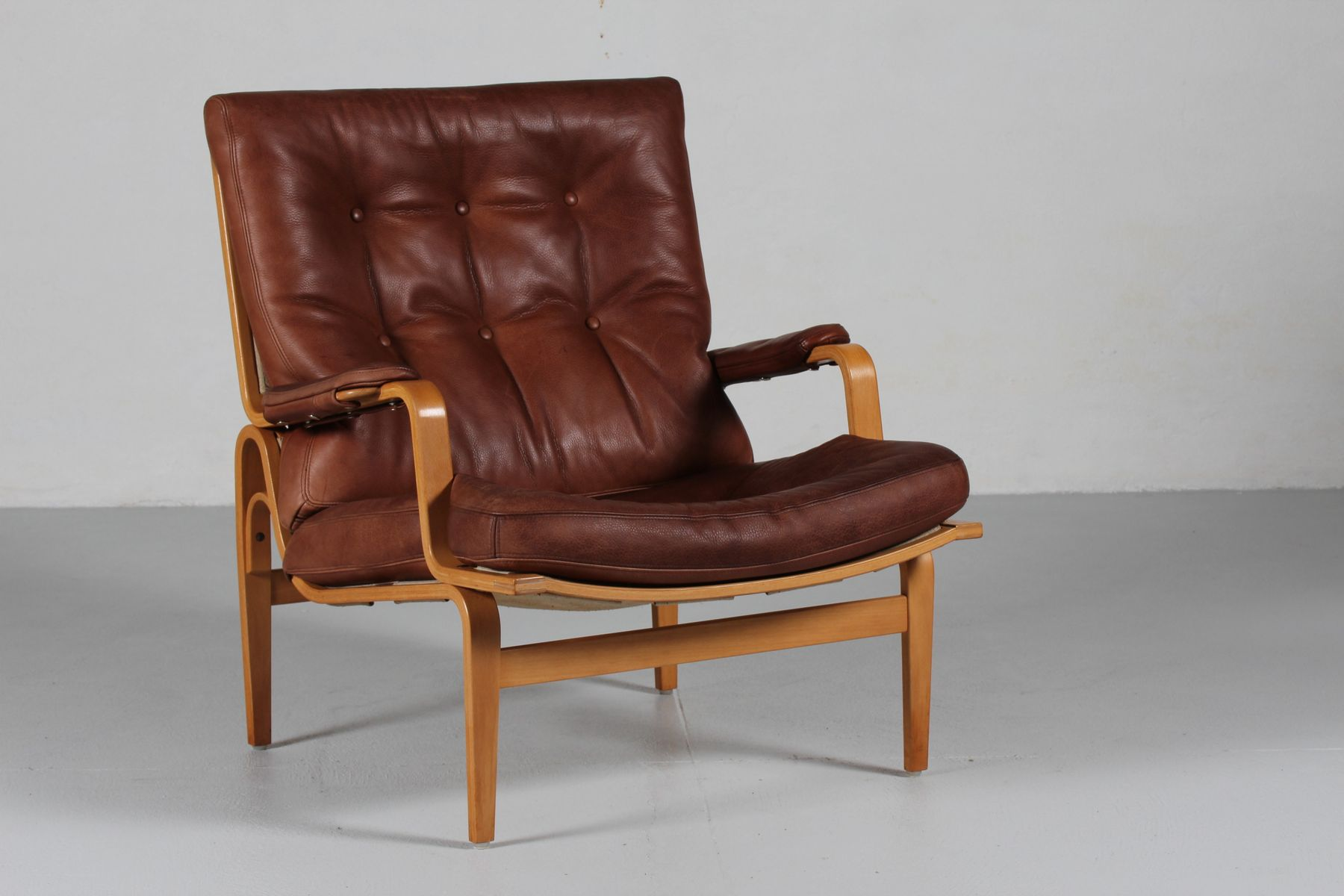 Ingrid cognac leather easy chair by bruno mathsson for dux for Cognac design